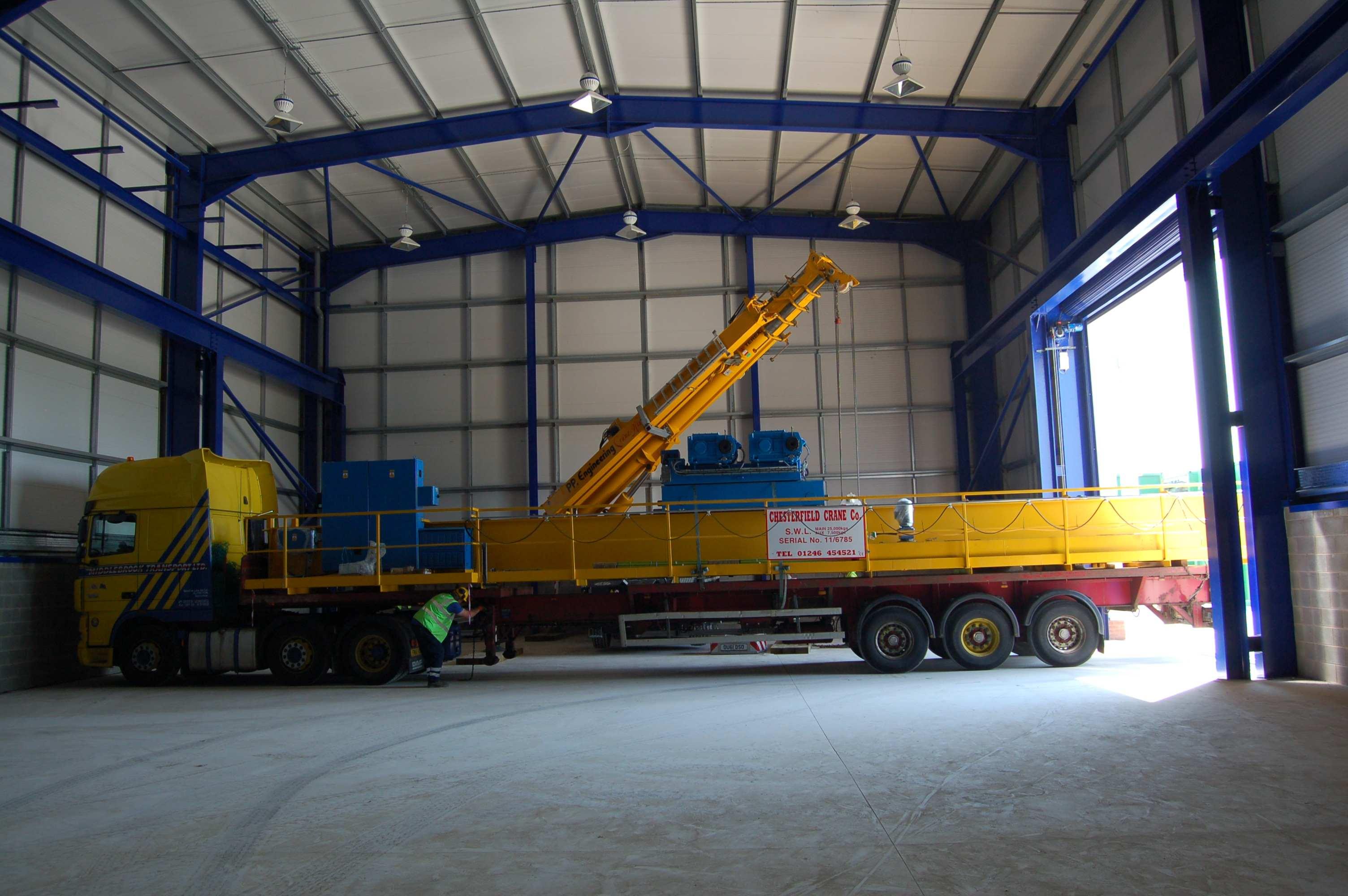 OHT crane arriving in workshop