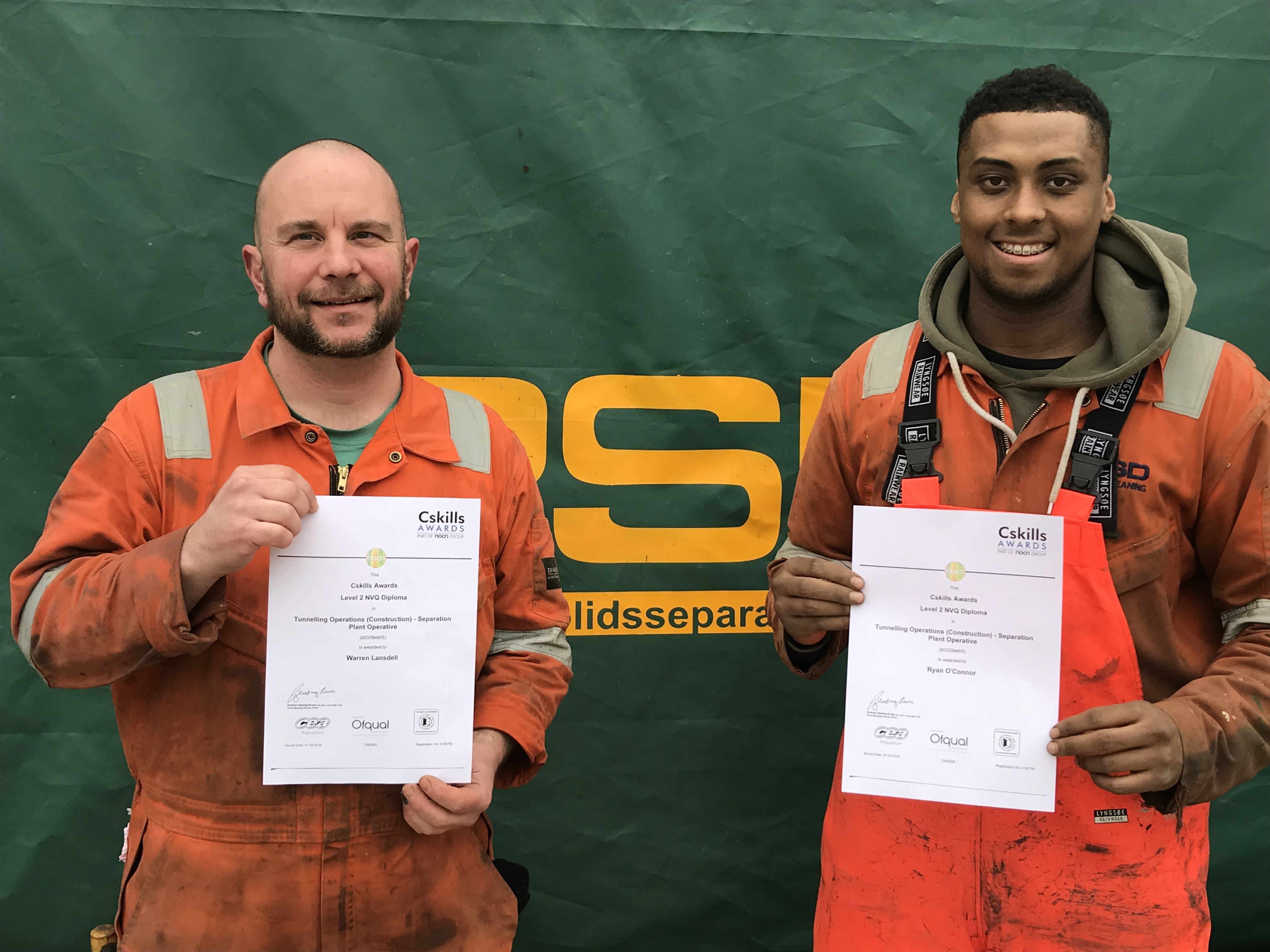 Warren & Ryan with their NVQ certificates